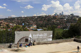 """A banner that reads """"Remembering 20 years"""" is erected at the Kigali Genocide Memorial grounds in Kigali, Apr. 2, 2014."""