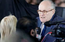FILE - Former New York City mayor Rudy Giuliani speaks to mourners ahead of a funeral service at the Billy Graham Library for Rev. Billy Graham, March 2, 2018, in Charlotte, N.C.
