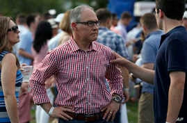 Environmental Protection Agency Administrator Scott Pruitt stands on the South Lawn during an afternoon picnic for military families at the White House, July 4, 2018, in Washington. President Donald Trump tweeted, Thursday, he has accepted Pruitt's r
