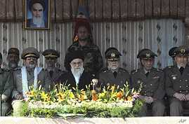 """Iran's Supreme Leader Ayatollah Ali Khamenei, who has vowed to respond to strikes against its nuclear facilities with """"iron fists,"""" with Iranian military brass at an army academy graduation, Tehran, Nov. 10, 2011."""