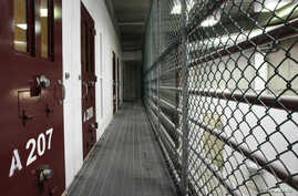 The interior of an unoccupied communal cell block is seen at Camp VI, a prison used to house detainees at the U.S. Naval Base at Guantanamo Bay March 5, 2013.
