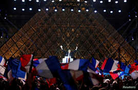 French President-elect Emmanuel Macron celebrates on the stage at his victory rally near the Louvre in Paris, France May 7, 2017.