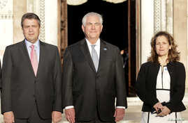 German Foreign Minister Sigmar Gabriel (L), U.S. Secretary of State Rex Tillerson (C) and Canada's Foreign Affairs Minister Chrystia Freeland, pose for a family photo during a G7 for foreign ministers in Lucca, Italy, April 10, 2017.