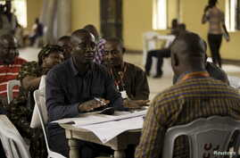 Independent National Electoral Commission Returning Officers submit their results sheets for colation at the city council in Port Harcourt, River state, March 29, 2015.