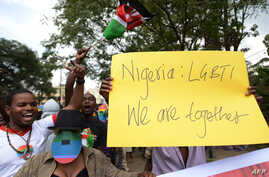 FILE - Kenyan gay and lesbian organisations demonstrate outside the Nigerian High Commission in Nairobi on February 7, 2014.