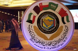 The seal of the Gulf Cooperation Council and an announcement of its meeting this week is on display in Kuwait City, Dec. 4, 2017.