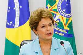 Handout picture released by the Brazilian Presidency's press office showing President Dilma Rousseff during a meeting with representatives of Trade Unions at the Planalto Palace in Brasilia, April 30, 2015.