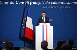 FILE - French President Emmanuel Macron delivers a speech prior to attend a dinner organised by the French Council of the Muslim Faith (CFCM) to break the fast of Ramadan, in Paris, June 20, 2017.