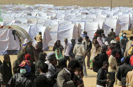 Migrant workers, who used to work in Libya and fled the recent unrest in the country, are seen in a refugee camp at the Tunisia-Libyan border, in Ras Ajdir, Tunisia, March 9, 2011. (AP Image)