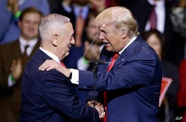 President-elect Donald Trump introduces retired Marine Corps Gen. James Mattis as his nominee for Secretary of Defense while speaking to supporters during a rally in Fayetteville, N.C., Dec. 6, 2016.