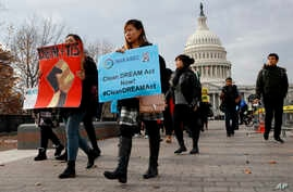 People march in support of the Deferred Action for Childhood Arrivals (DACA), and Temporary Protected Status (TPS), programs, Dec. 5, 2017, on Capitol Hill in Washington.
