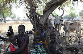 A handout picture released by the UN on January 5, 2012 shows internally displaced persons resting in Pibor, Jonglei state after fleeing the surrounding areas following a wave of bloody ethnic violence.