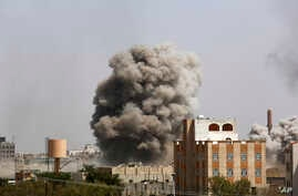 Smoke rises after a Saudi-led airstrike hits an army academy in Sanaa, Yemen, Sunday, Sept. 20, 2015.