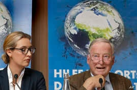 Alice Weidel, left, and Alexander Gauland, right, top candidates of the German AfD (Alternative for Germany) party for the upcoming general elections, attend a press conference in Berlin, Germany, Monday, Aug. 21, 2017.