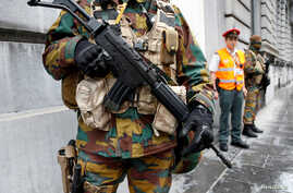 A Belgian soldier stands guard outside the prime minister's office building during a meeting of the government's security council in Brussels, June 18, 2016.