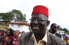 FILE - Prince Johnson, who at the time was a presidential candidate, campaigns in the village of Demeh in Bomi County, Liberia, Sept. 14, 2011. The former warlord has endorsed George Manneh Weah in next month's presidential runoff.