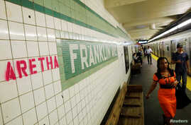 """Aretha"" is spray painted next to a sign at the Franklin Street subway station, in memory of singer Aretha Franklin, in the Brooklyn borough of New York, Aug. 16, 2018."
