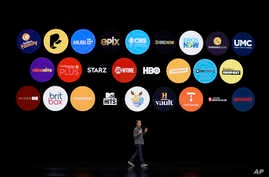 Peter Stern, Apple Vice President of Services, speaks at the Steve Jobs Theater during an event to announce new products, March 25, 2019, in Cupertino, California.