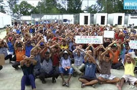 In this file photo made from Australia Broadcasting Corporation video taken shows asylum seekers protesting the possible closure of their detention center on Manus Island, Papua New Guinea, Oct. 31, 2017.