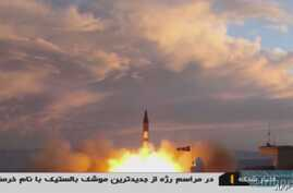 A TV grab taken Sept. 23, 2017, from Iranian Republic Islamic Broadcasting shows a Khoramshahr missile being launched from an undisclosed location, a day after the missile was first displayed at a high-profile military parade in the capital, Tehran.