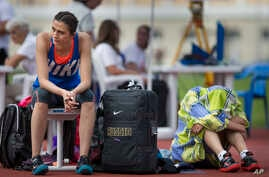 Russia's Maria Kuchina, left, prepares to compete in the Russian Athletics Cup, at Zhukovsky, outside Moscow, Russia, July 21, 2016.
