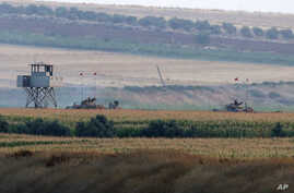 Turkish army tanks hold positions near the border with Syria, in the outskirts of the village of Elbeyi, east of the town of Kilis, in southeaster Turkey, July 23, 2015.