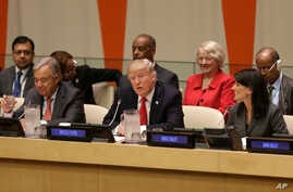 FILE - U.S. President Donald Trump, center, speaks while United Nations Secretary-General Antonio Guterres, left, and U.S. Ambassador to the United Nations Nikki Haley look on, at U.N. headquarters, Sept. 18, 2017.