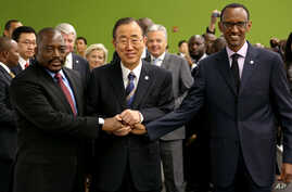 United Nations Secretary-General Ban Ki-moon, center, joins hands with President of the Democratic Congo Joseph Kabila Kabange, left, and President of Rwanda Paul Kagame at the 67th session of the General Assembly at United Nations Headquarters, Sept