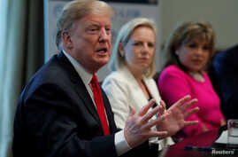 "U.S. President Donald Trump speaks during a meeting to ""discuss fighting human trafficking on the southern border"" with Department of Homeland Security Secretary Kirstjen Nielsen, center, and International Network of Hearts President Alma Tucker in t"