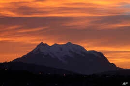 Illimani Mountain is capped with snow at dawn near La Paz, Bolivia, Oct. 23, 2013.