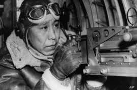 This 1943 file photo shows Sgt. Gilbert Eagle Feather, Lakota from Rosebud, S.D., at the waist gun of his B-17 Flying Fortress, Dec. 24, 1943.