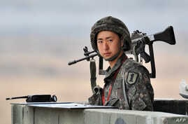 South Korean soldier stands on a military guard post near the demilitarized zone (DMZ) dividing the two Koreas in the border city of Paju on April 5, 2013.