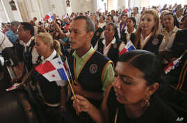Electoral tribunal members during a Mass at the Metropolitan Cathedral, also attended by presidential candidates, in Panama City, May 3, 2014.