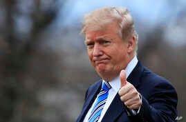 President Donald Trump gestures to the media as he leaves the White House, Friday, Feb. 16, 2018, in Washington, for a trip to his private Mar-a-Lago resort in Florida.