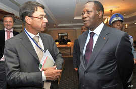 Ivory Coast's internationally recognized president Alassane Ouattara  (R) chats with Koen Vervaeke, EU's Ambassador to the African Union during his meeting with around 30 diplomats on March 11, 2011 in Addis Ababa