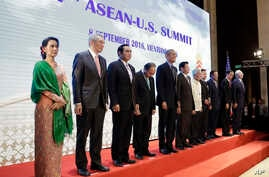 U.S. President Barack Obama, fifth left, poses for a family photos during the ASEAN-U.S. Summit Meeting at National Convention Center in Vientiane, Laos, Thursday, Sept. 8, 2016.