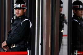 Military policemen provide security at the Army Club before Thailand's army chief begins meeting with groups and organisations with a central role in the crisis, in central Bangkok, May 21, 2014.