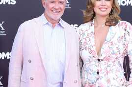 """Alan Thicke and wife Tanya Callau at the premiere of """"Bad Moms."""" Thicke died of a heart attack Dec. 13, 2016."""