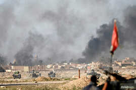 Smoke rises during a battle between Islamic State fighters and Iraqi troops at an outskirts of Mosul, Iraq, Feb. 25, 2017