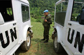 A UN soldier stands guard in the Walikale territory, in the Democratic Republic of Congo, July 27, 2006. After six years on the run, warlord Ntabo Ntaberi Sheka surrendered to U.N. forces in the town of Mutongo.