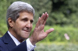 U.S. Secretary of State John Kerry waves as he arrives for a meeting with Israeli Prime Minister Benjamin Netanyahu at Villa Taverna in Rome October 23, 2013. REUTERS/Claudio Peri/Pool   (ITALY - Tags: POLITICS) - RTX14L17