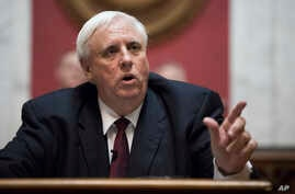 FILE - Governor Jim Justice delivers his first State of the State speech in Charleston, W.Va., Feb. 8, 2017.