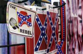 Confederate flag-themed stickers are displayed at Arkansas Flag and Banner in Little Rock, Ark., Tuesday, June 23, 2015.