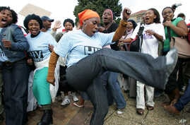 FILE - Treatment Action Campaign supporters chant and dance during a protest demonstration in Cape Town, South Africa.
