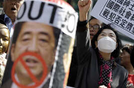 Protesters shout slogans during a rally against Japanese Prime Minister Shinzo Abe's policy about South Korean wartime sex slaves from the Japanese government in front of the Japanese Embassy in Seoul, South Korea, April 1, 2015.