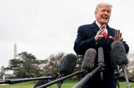 President Donald Trump speaks to members of the media before boarding Marine One on the South Lawn of the White House in Washington,  Nov. 26, 2018, for a short trip to Andrews Air Force Base, Maryland, and then on to Mississippi for rallies.