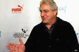 FILE - Actor and director Harold Ramis walks the Red Carpet as he arrives to celebrate The Second City's 50th anniversary in Chicago, Dec. 12, 2009.