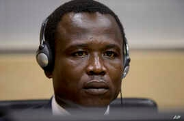 Dominic Ongwen, a Ugandan commander in warlord Joseph Kony's feared militia, waits for the judge to arrive as he made his first appearance at the International Criminal Court in The Hague, Netherlands, Jan. 26, 2015.