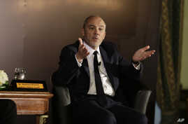Stephane Richard, CEO of the French mobile phone company Orange, said Monday he would visit Israel. He's shown at a press conference in Cairo June 3, 2015.