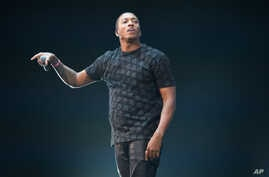 "FILE - In this Dec. 19, 2014 file photo, Lecrae performs at Christmas in Brooklyn in New York. Lecrae was named artist of the year at the 46th annual Dove Awards for his chart-topping album, ""Anomaly,"" Dec. 19, 2014."